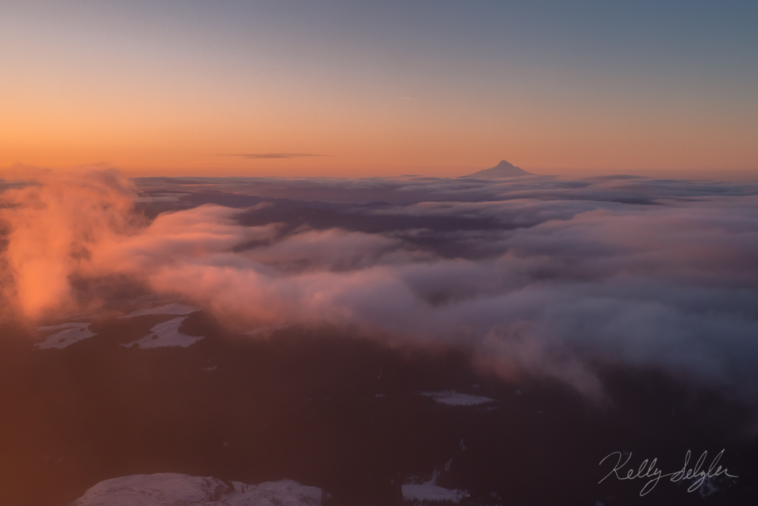 As I was climbing Mt. St. Helens and fighting the torrential winds, I turned around and saw this beautiful sunrise looking towards...