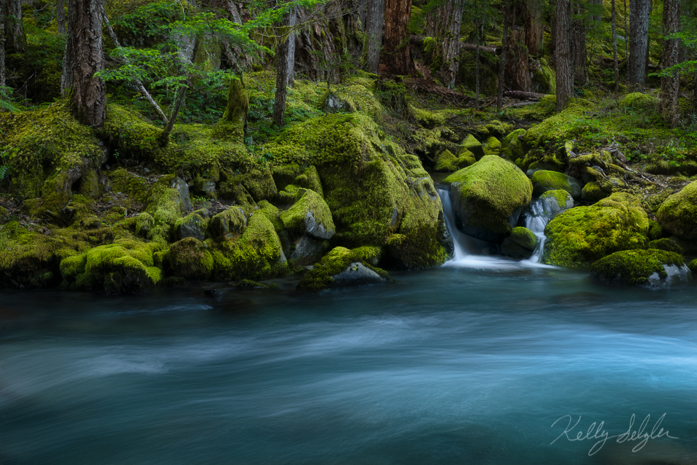 The glow of a turquoise river and the surprise of a tiny waterfall.